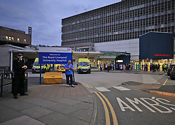 A police officer joins staff from the Royal Liverpool University Hospital in a national applause during Thursday's nationwide Clap for Carers NHS initiative to applaud NHS workers fighting the coronavirus pandemic.
