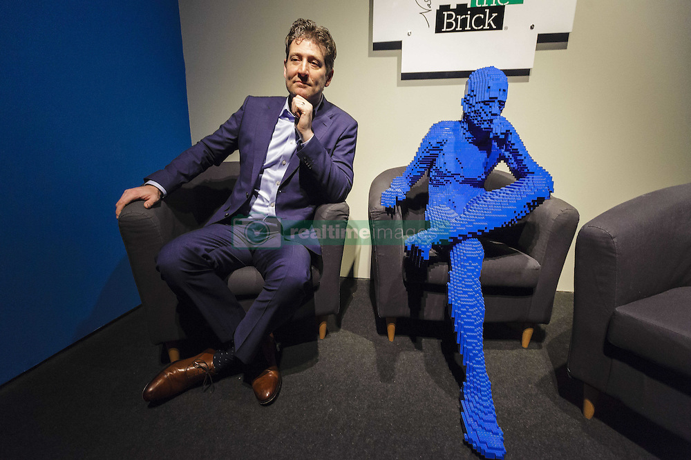 December 9, 2016 - Rome, Italy - Nathan Sawaya poses for a photo during 'The Art Of The Brick' exhibition preview at the Auditorium Parco della Musica in Rome, Italy. The exhibition opens to the public on December 9 and runs until February 26, 2017. Nathan Sawaya is an American-based artist who builds custom three-dimensional sculptures and large-scale mosaics from popular everyday items and is best known for his work with standard LEGO toy bricks. (Credit Image: © Giuseppe Ciccia/Pacific Press via ZUMA Wire)