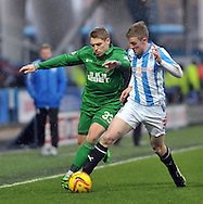 Paul Dixon of Huddersfield Town challanges Martyn Waghorn of Wigan Athletic during the Sky Bet Championship match at the John Smiths Stadium, Huddersfield<br /> Picture by Graham Crowther/Focus Images Ltd +44 7763 140036<br /> 08/02/2014