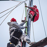Leg 7 from Auckland to Itajai, day 12 on board MAPFRE, Antonio Cuervas-Mons and Nervio putting the track on the mast, 29 March, 2018.