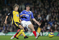 Photo: Lee Earle.<br /> Portsmouth v Wigan Athletic. The Barclays Premiership. 05/11/2005. Wigan's Jimmy Bullard (L) battles with Gregory Vignal.