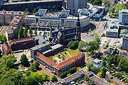 Nederland, Noord-Brabant, Eindhoven, 09-05-2013; Centrum Eindhoven ten zuiden van de het station. Kanaalstraat overgaand in Vestdijk. Aan de Kanaalstraat H. Hart van Jezus (Paterskerk, met beeld Heilig Hartbeeld, in de volksmond Jezus Waaghals op de torenspits) en voormalige Augustijner Klooster Mariënhage aan de Augustijnendreef. <br /> Center Eindhoven, former Augustinian monastery Mariënhage<br /> luchtfoto (toeslag op standard tarieven);<br /> aerial photo (additional fee required);<br /> copyright foto/photo Siebe Swart