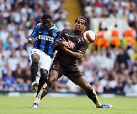 Photo: Chris Ratcliffe.<br /> Tottenham Hotspur v Inter Milan. Pre Season Friendly. 28/07/2006.<br /> Tom Huddlestone of Spurs (R) clashes with Obafemi Martins of Inter.