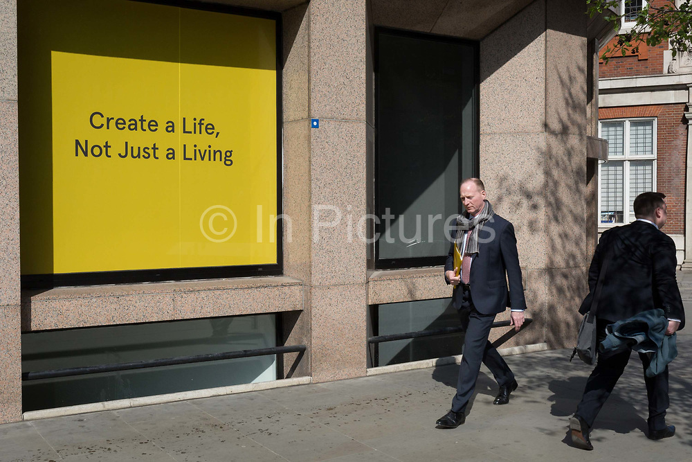 A create a life, not just for living slogan outside offices in the City of London, the capitals financial district, on 1st April, 2019, in London England.