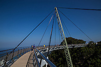 Langkawi Sky Bridge is a curved pedestrian bridge built on top of Mt. Machinchang at a height of 700 meters above sea level. The bridge is suspended from a 82 meter pylon swinging out over the landscape to give visitors a unique view of the surrounding area and neighboring islands.