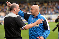 Richard Money, the Cambridge United manager (r) and Paul Cook, the Portsmouth manager talking before k/o. Skybet football league two match, Cambridge Utd v Portsmouth at the Abbey Stadium  in Cambridge on Saturday 10th October 2015.<br /> pic by John Patrick Fletcher, Andrew Orchard sports photography.
