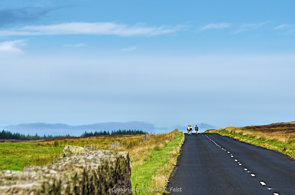 We had stopped at the side of the road in County Antrim, Northern, Ireland to take some pictures.  As I turned to go back to the car, a local cycling club rode by taking advantage of a spectacular day.