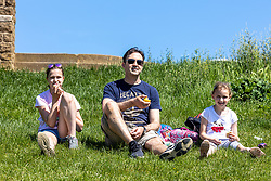 Licensed to London News Pictures. 01/06/2021. Dorking, UK. On the hottest day of the year so far, a family from Epsom, Surrey enjoy a walk in the sunshine up Box hill, Surrey this morning. The Met Office have forecast very warm weather for the South East and London this week with temperatures predicted to hit up to 26c today and over 27c tomorrow. Photo credit: Alex Lentati/LNP