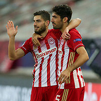 PIRAEUS, GREECE - OCTOBER 21: Giorgos Masouras of Olympiacos FC and Andreas Bouchalakis of Olympiacos FC during the UEFA Champions League Group C stage match between Olympiacos FC and Olympique de Marseille at Karaiskakis Stadium on October 21, 2020 in Piraeus, Greece. (Photo by MB Media)