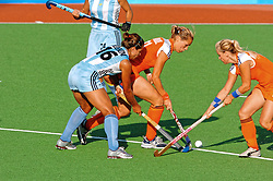 Fatima Moreira de Melo, Lieve van Kessel of the Netherlands in action against Argentina during Olympics Games Athletics day 12 on August 24, 2004 in Olympiako Kentro Khokei, Athens.