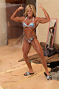 Woman bikini competitor shows the pose she believes will win her the competition.