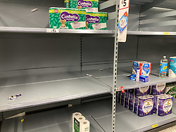 © Licensed to London News Pictures. 22/12/2020. London, UK. Empty shelves in the loo roll section as a rush of Christmas shoppers descend on Asda in South West London today causing long queues in the aisles after news of a French travel ban to Europe which has blocked freight from leaving the Port of Dover after a spike of infections due to the Covid-19 mutation. Last week Prime Minister Boris Johnson put London and parts of the South East into Tier 4 lockdown after the new Covid-19 mutation was discovered. Photo credit: Alex Lentati/LNP