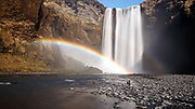 A rainbow over Skógafoss waterfall in southern Iceland