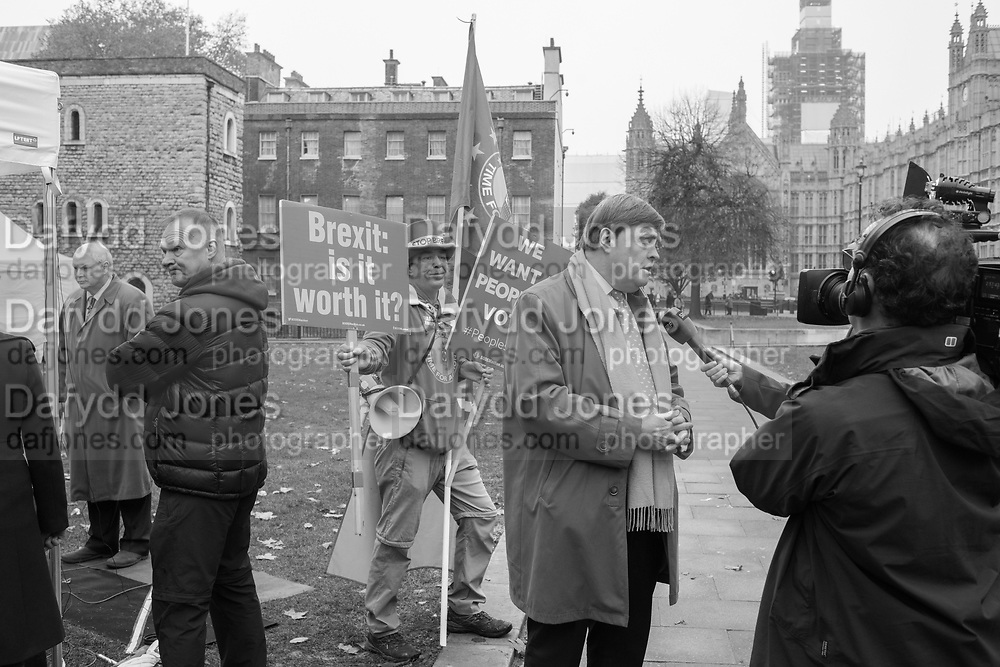 David Campbell-Bannerman being interviewed outside Commons. Steve Bray for Remain behind. London. 16 Nov 2018