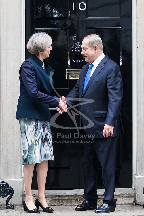 Downing Street, London, February 6th 2017. Israeli Prime Minister Benjamin Netanyahu arrives at 10 Downing Street for lunchtime talks with British Prime Minister Theresa May, with some confusion arising when Mrs May was not immediately on hand to welcome him. Minutes later the two PMs emerged for the traditional handshake photographs at the door of No 10. PICTURED: Theresa May and Benjamin Netanyahu emerge from 10 Downing Street for the traditional handshake pictures.