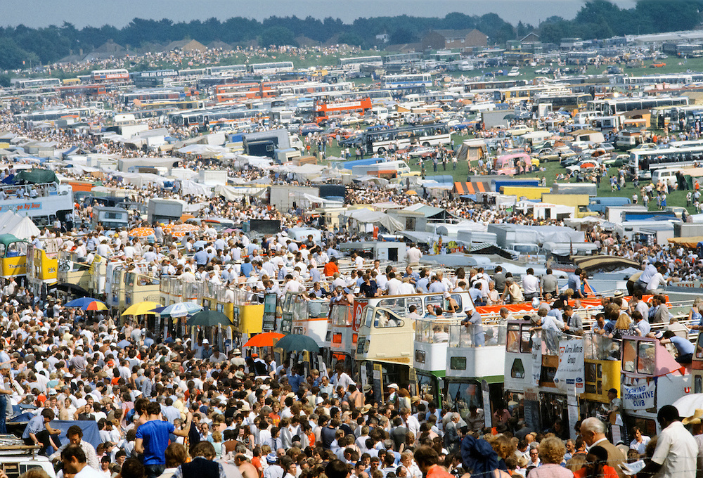 Crowds of spectactors on traditional open-topped buses at Epsom Racecourse for Derby Day, UK