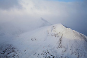A break in the clouds reveals Torreys Peak 14,267ft in the distance and a streak of light graces Kelso Peak.