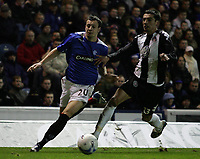 Photo: Paul Thomas.<br /> Glasgow Rangers v Partizan Belgrade. UEFA Cup. 14/12/2006.<br /> <br /> Ranger and later winning goal scorer Alan Hutton (L) tries to go around Marko Lomic.