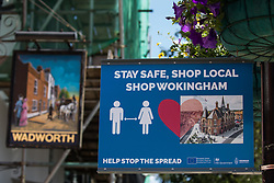 Wokingham, UK. 8th June, 2021. A sign advises residents to use local shops amid rising concern regarding the spread of the Covid-19 Delta variant. Surge testing has been introduced in some local postcodes after a small number of cases of the Delta variant first identified in India were confirmed in the Wokingham area.