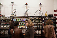 Customers buying goods in 'Halep', a Syrian shop in Armenia's capital, Yerevan, stocked with produce from Aleppo, Syria.