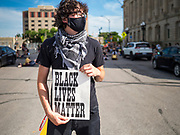 08 JUNE 2020 - DES MOINES, IOWA: A Black Lives Matter protester pickets the front of Des Moines City Hall during a council debate of a racial profiling ordinance. About 150 people staged a sit-in in front of the Des Moines City Hall Monday afternoon and listened to the City Council debate an ordinance about racial profiling. The sit-in was organized by Des Moines' Selma, a civil rights organization based in Des Moines. Des Moines' African-American community has sponsored and coordinated a series of events to draw attention to police violence in Des Moines in the wake of George Floyd's death at the hands of Minneapolis police.       PHOTO BY JACK KURTZ