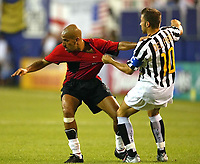 Photo Aidan Ellis.<br />Manchester United v juventus (Champions World Match at New York Giants Stadium East Rutherford).31/07/03.<br />Juve's Alessandro Del Piero gets to grips with United's Juan Sebastian Veron
