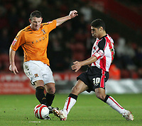 Photo: Lee Earle/Sportsbeat Images.<br /> Southampton v Hull City. Coca Cola Championship. 08/12/2007. Hull's Dean Windass (L) and Southampton's Youssef Safri.