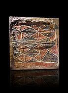 Wall fresco of geometric red and black triangles which appears to be a rug pattern copy. 6000 BC. . Catalhoyuk Collections. Museum of Anatolian Civilisations, Ankara. Against a black background .<br /> <br /> If you prefer you can also buy from our ALAMY PHOTO LIBRARY  Collection visit : https://www.alamy.com/portfolio/paul-williams-funkystock/prehistoric-neolithic-art.html - Type Catalhoyuk into the LOWER SEARCH WITHIN GALLERY box. Refine search by adding background colour, place, museum etc.<br /> <br /> Visit our PREHISTORIC PLACES PHOTO COLLECTIONS for more  photos to download or buy as prints https://funkystock.photoshelter.com/gallery-collection/Prehistoric-Neolithic-Sites-Art-Artefacts-Pictures-Photos/C0000tfxw63zrUT4
