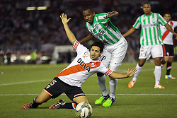 10.12.2014, River Plate Stadium, Buenos Aires, ARG, Südamerika Cup 2014, River Plate vs Atletico Nacional de Medellin, im Bild River Plate Leonardo Pisculicchi (left) and Juan Valencia (right) from Atletico Nacional de Medellin // during the 2nd final match of Southamerican Cup between River Plate vs Atletico Nacional and Medellin at the River Plate Stadium in Buenos Aires, Argentina on 2014/12/10. EXPA Pictures © 2014, PhotoCredit: EXPA/ Eibner-Pressefoto/ Cezaro<br /> <br /> *****ATTENTION - OUT of GER*****