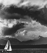 Black clouds of a spring squall boil over Shilshole Bay as a sailboat clears the breakwater. (Josef Scaylea / The Seattle Times, 1970)