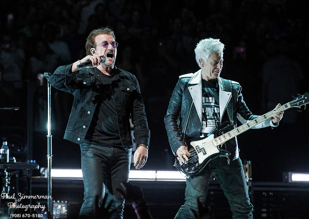NEWARK, NJ - JUNE 29:    Bono and Adam Clayton of U2 perform onstage during the eXPERIENCE + iNNOCENCE TOUR at Prudential Center on June 29, 2018 in Newark, New Jersey.  (Photo by Paul Zimmerman/Getty Images) *** Local Caption *** Bono; Adam Clayton