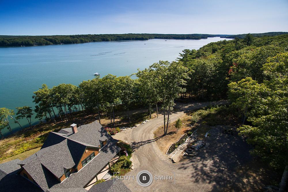 Custom home designed and built into a rock ledge along the Damarisicotta River.