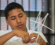 Senior Osmar Barrera works on a straw bridge during a summer intern program with FH-HP at Washington High School, June 16, 2014.