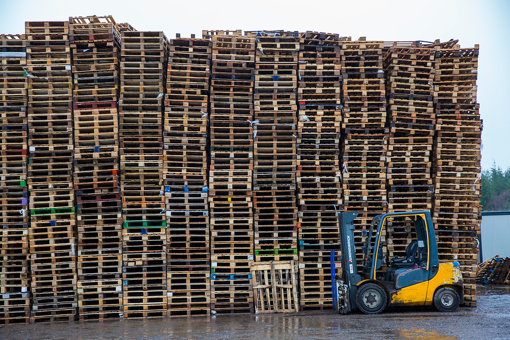 A pallet truck parked in front of a large stack of wooden pallets on an industrial site near the M74 on the edge of Happendon Wood near Lanark, Scotland. <br /> (photo by Andrew Aitchison / In pictures via Getty Images)