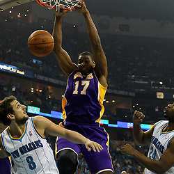 April 28, 2011; New Orleans, LA, USA; Los Angeles Lakers center Andrew Bynum (17) dunks over New Orleans Hornets shooting guard Marco Belinelli (8) and power forward Carl Landry (24) during the first quarter in game six of the first round of the 2011 NBA playoffs at the New Orleans Arena.    Mandatory Credit: Derick E. Hingle