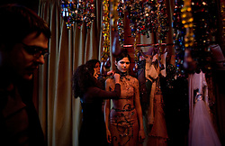 Models prepare backstage to show the clothes of Lebanese fashion designer Nadine Mezher, Beirut, Lebanon, March 25, 2006. The show, held at Buddha Bar nightclub, is part of Beirut Fashion Week.