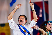 """10 JANUARY 2007 - MANAGUA, NICARAGUA:  DANIEL ORTEGA, newly inaugurated president of Nicaragua, and his wife, ROSARIO MURILLO, wave to the crowd in Plaza de Fe during his inaugural speech. Ortega, the leader of the Sandanista Front, was sworn in as the President of Nicaragua Wednesday. Ortega and the Sandanistas ruled Nicaragua from their victory of """"Tacho"""" Somoza in 1979 until their defeat by Violetta Chamorro in the 1990 election.  Photo by Jack Kurtz"""