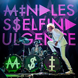 © Licensed to London News Pictures . 04/12/2013 . Manchester , UK . Jimmy Urine ( James Euringer ) steps in to the drums as Kitty ( Jennifer Dunn ) drums . Mindless Self Indulgence ( MSI ) play the Ritz in Manchester . Photo credit : Joel Goodman/LNP
