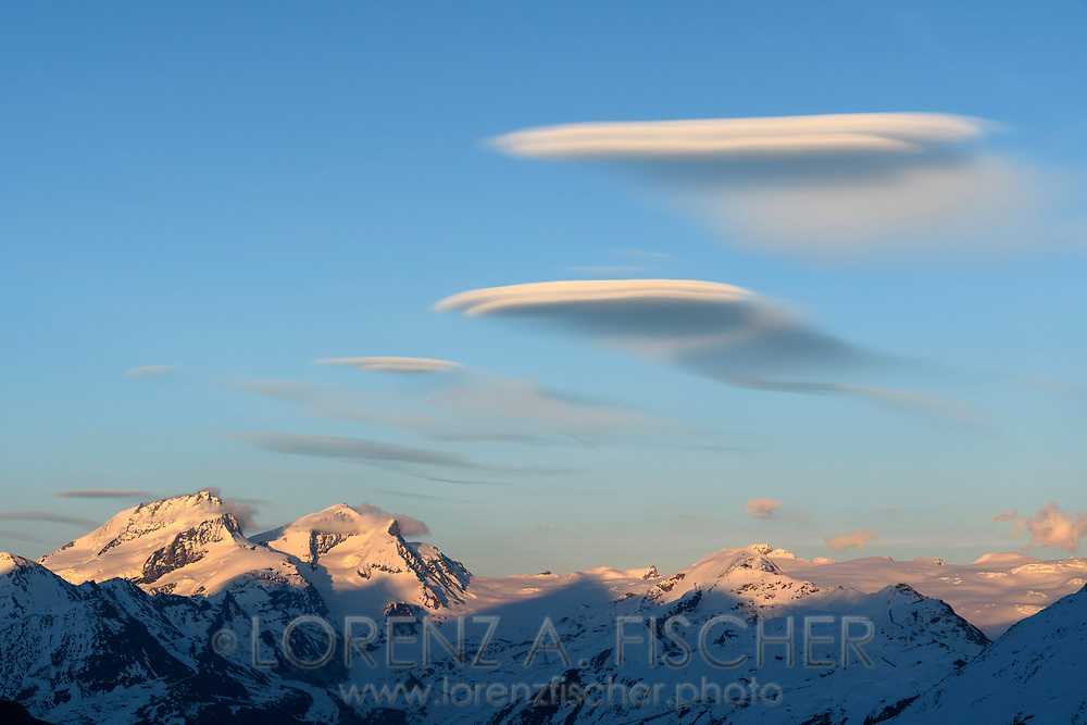 Lenticular clouds over the Rimpfischhorn and Strahlhorn seen from the Schönbielhütte, Valais, Switzerland