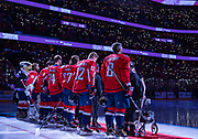 Six Make-A-Wish Children, all honorary members of the Washington Capitals starting lineup, join players on the ice for a ceremony before the team takes on the Vancouver Canucks at Capital One Arena on November 23, 2019.