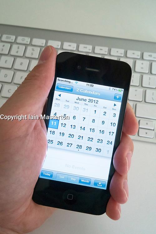 Using a Calendar App on an iPhone smartphone