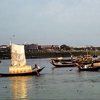 Boats ply delta waters of the Brahmaputra River near Dhaka, Bangladesh. 1977