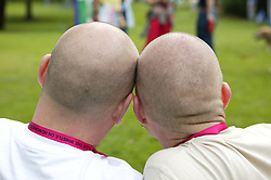 Couple of men with bald heads at the Nottingham Pride Gay Lesbian festival; held at the Arboretum,
