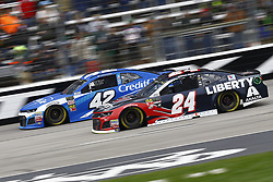April 8, 2018 - Ft. Worth, Texas, United States of America - April 08, 2018 - Ft. Worth, Texas, USA: Kyle Larson (42) and William Byron (24) battle for position during the O'Reilly Auto Parts 500 at Texas Motor Speedway in Ft. Worth, Texas. (Credit Image: © Chris Owens Asp Inc/ASP via ZUMA Wire)