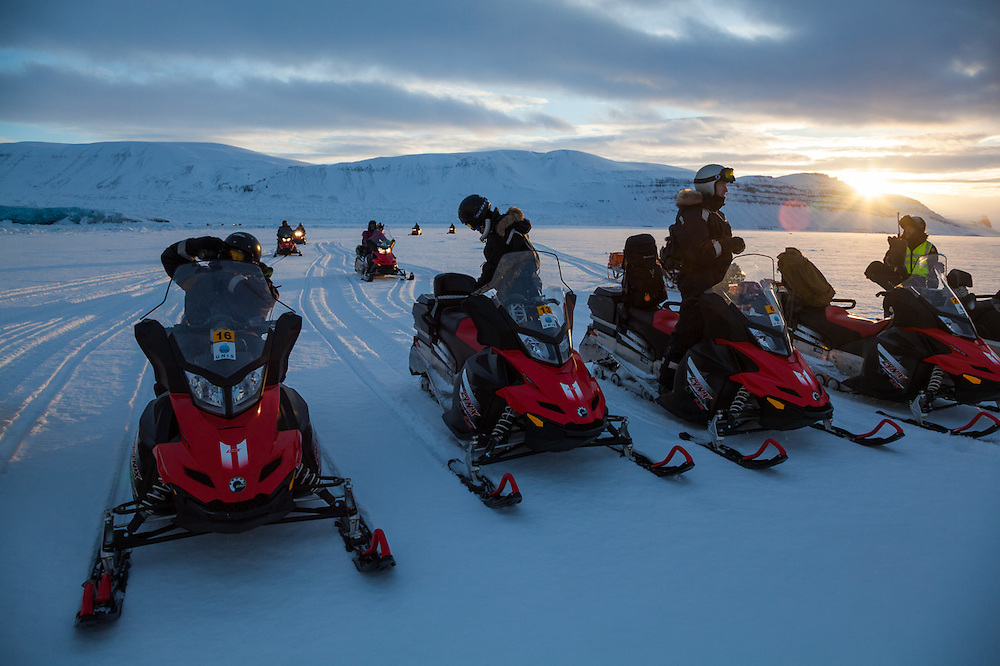 UNIS students park their snowmobiles on sea ice in Tempelfjorden at the terminus of Tunabreen, Svalbard.