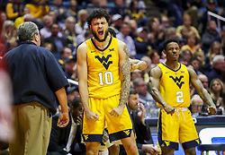 Feb 2, 2019; Morgantown, WV, USA; West Virginia Mountaineers guard Jermaine Haley (10) celebrates from the bench during the second half against the Oklahoma Sooners at WVU Coliseum. Mandatory Credit: Ben Queen-USA TODAY Sports