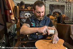 Leather tooling at Motor Bike Expo. Verona, Italy. Sunday January 22, 2017. Photography ©2017 Michael Lichter.