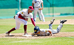 Darren Boltman of the Bothasig Knights recovers to first base ahead of the tag of Charl Cordier of the Bellville Tygers during the Major league game held at the Tygers' home ground at the PP Smit stadium in Bellville on 23 October 2016. Photo by John Tee/RealTime Images.