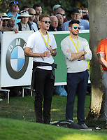 Golf - 2019 BMW PGA Championship - Thursday, First Round<br /> <br /> England cricketers Stuart Broad and Jimmy Andrerson watch Matt Wallace and Tommy Fleetwood at the 18th hole, at the West Course, Wentworth Golf Club.<br /> <br /> COLORSPORT/ANDREW COWIE