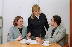 Group of office workers talking in staff meeting,